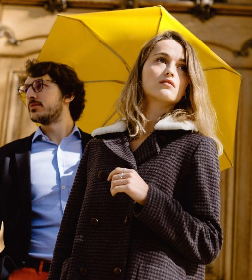 Yellow umbrella with man and woman