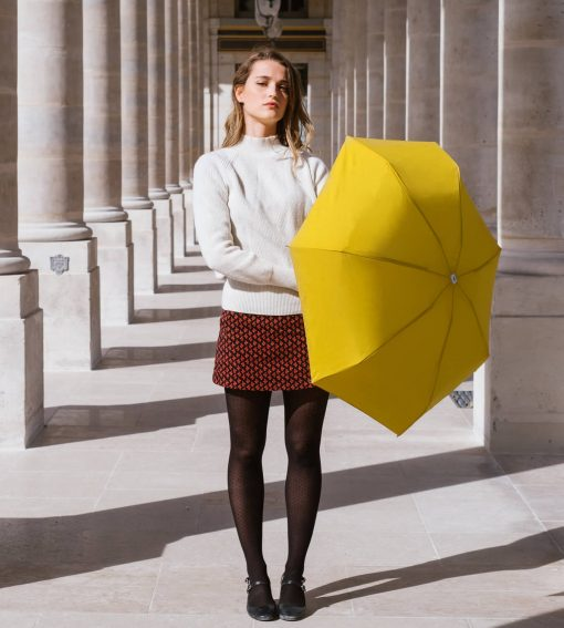 Woman in Paris and yellow umbrella