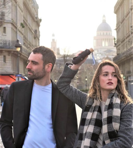 Couple in paris with black umbrella - Anatole